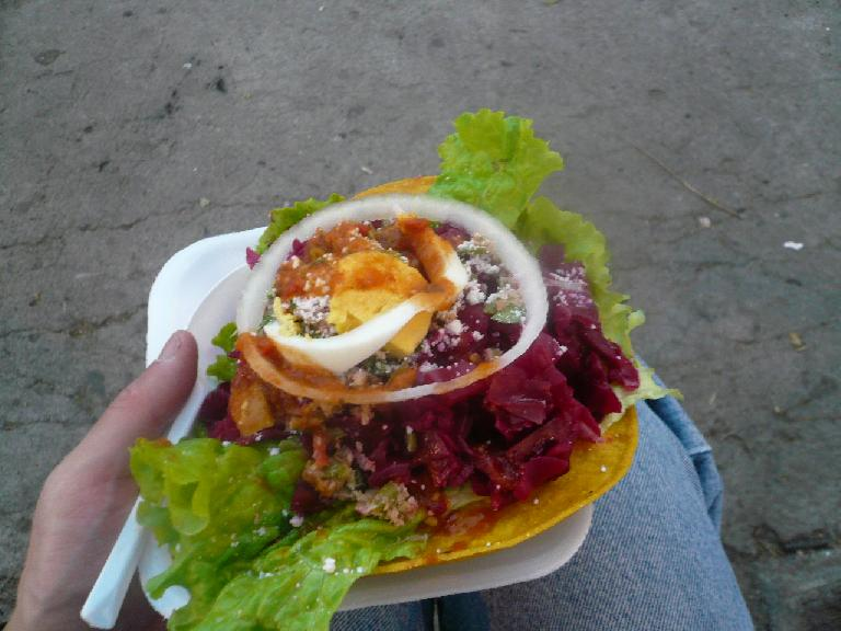 This crispy tortilla with lettuce, radishes, onion and cheese was delicious.  It was Q7 (USD$0.89) in Antigua, Guatemala.  I'm not sure what the actual name of it is. (December 26, 2010)