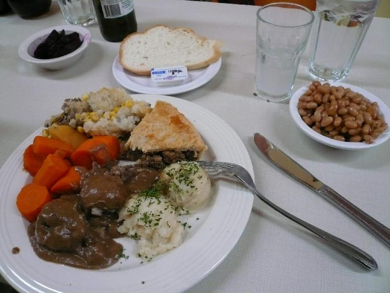 """More authentic Quebecois cuisine: Ragout de Pattes et Boulettes (not sure of the translation, but there was a stew-like meat with mashed potatoes), Pate Chinois (""""Chinese Smear"""" consisting of corn, beef,  and potatoes), and baked beans with some maple syrup."""