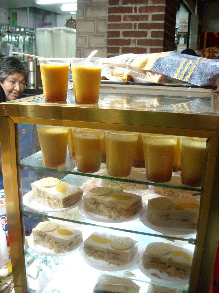 Deserts from another street vendor.  We had the flan (top), and another day tried the pastries that were like cake with a cookie on top (on the bottom shelves in the photo).