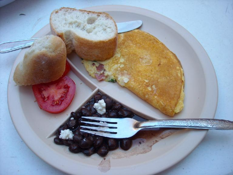 The usual breakfast at Hostal Pochon -- the hostel we stayed in -- consisted of bread, tomatoes, omelets, and black beans with some queso fresco. (December 26, 2009)