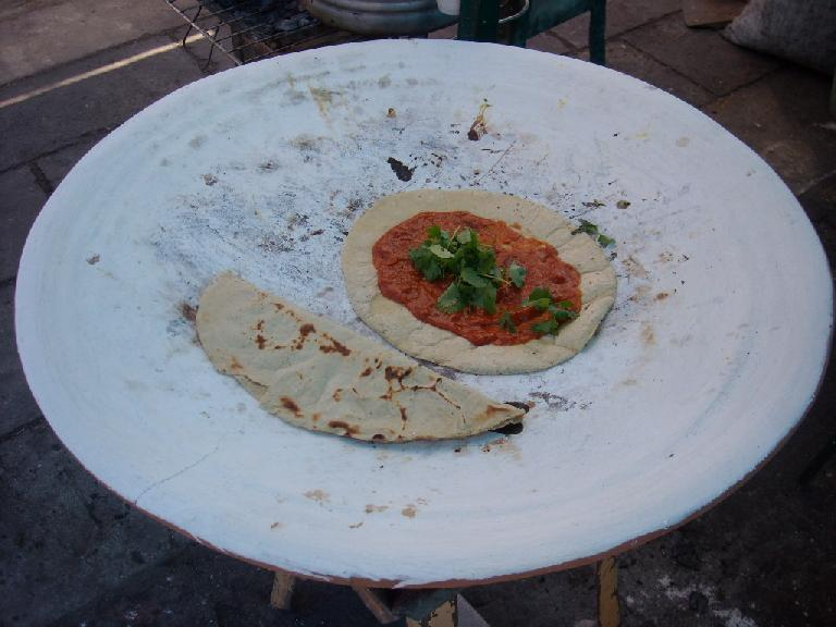 Empanadas being made for us from the street food vendor near La Iglesia de Santo Domingo. (December 26, 2009)