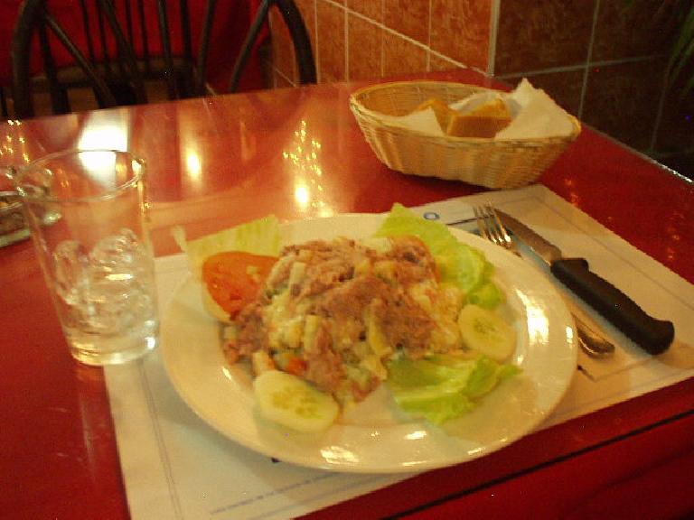 I enjoyed this wonderful meal of ensalada de patatas con tuna (potato salad with tuna) y pan (bread) outdoors in Panama City.  Just $4.10! (February 27, 2007)