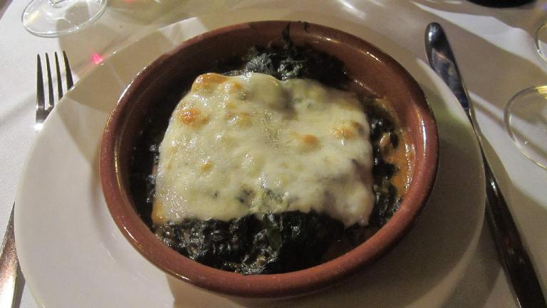 Some sort of stew with cheese.