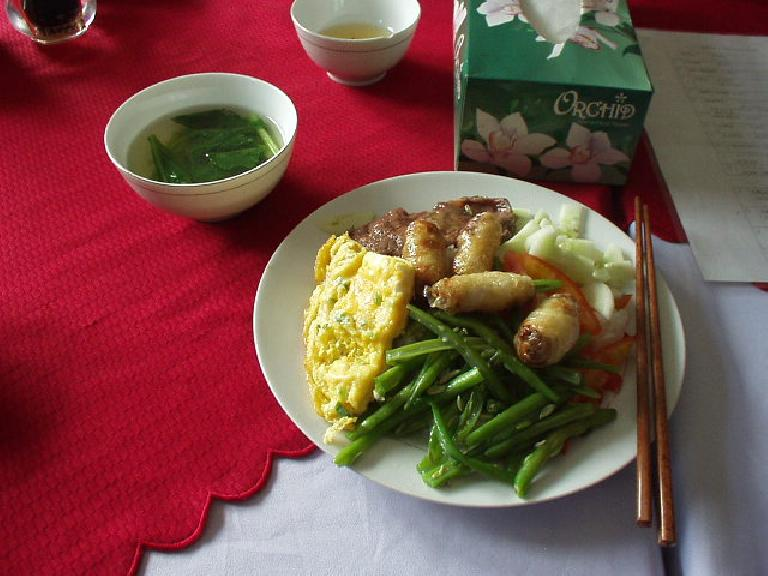 Egg rolls, fried egg, green beans, cucumber, steak and soup before Perfume River cruise. (July 10, 2006)