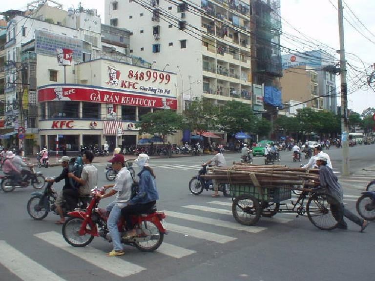 KFC in Saigon, and how to transport a bunch of poles. (July 4, 2006)