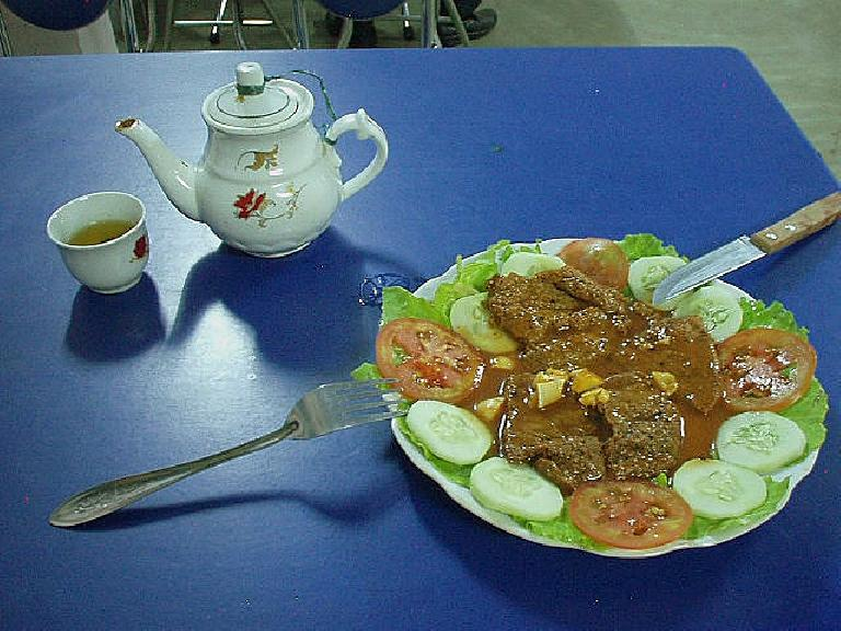 Beef steak with vegetables in Hue. (July 8, 2006)