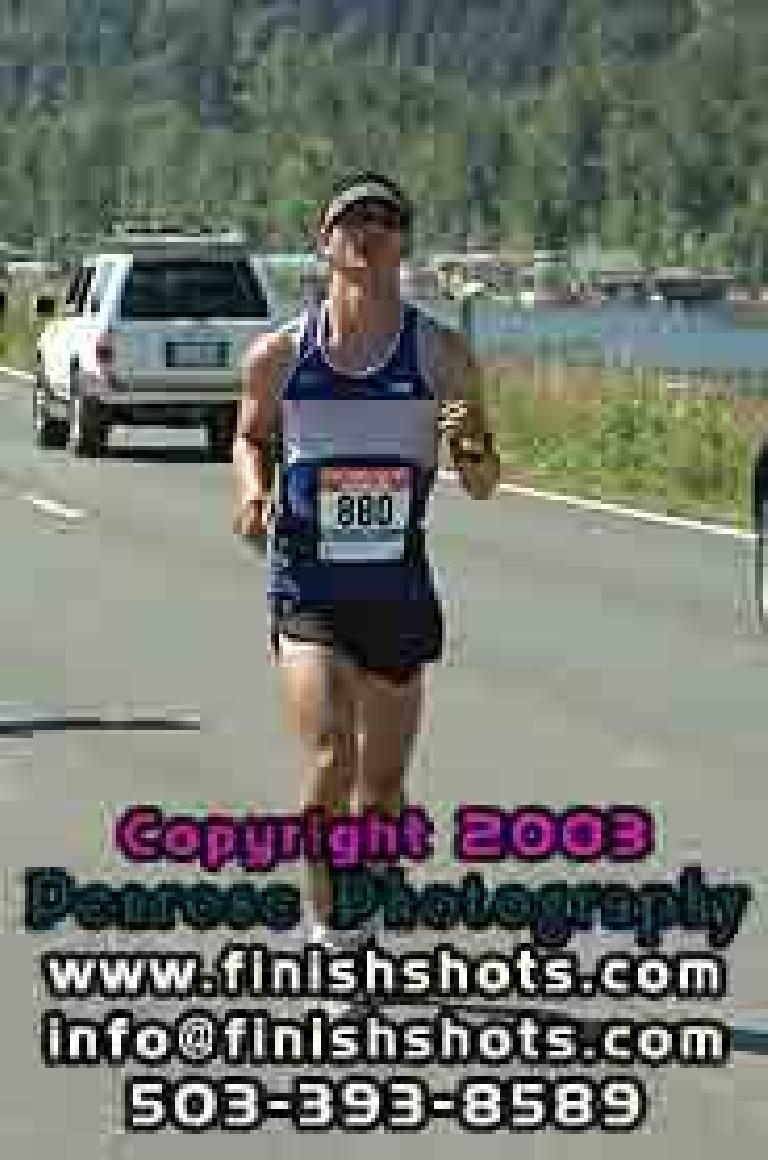 [Mile 13, 1:41:00 elapsed) Felix Wong about to finish lap 1 around Sauvie Island. Photo: finishshots.com.