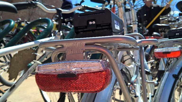 Rear taillight on Zagster city share bicycle.