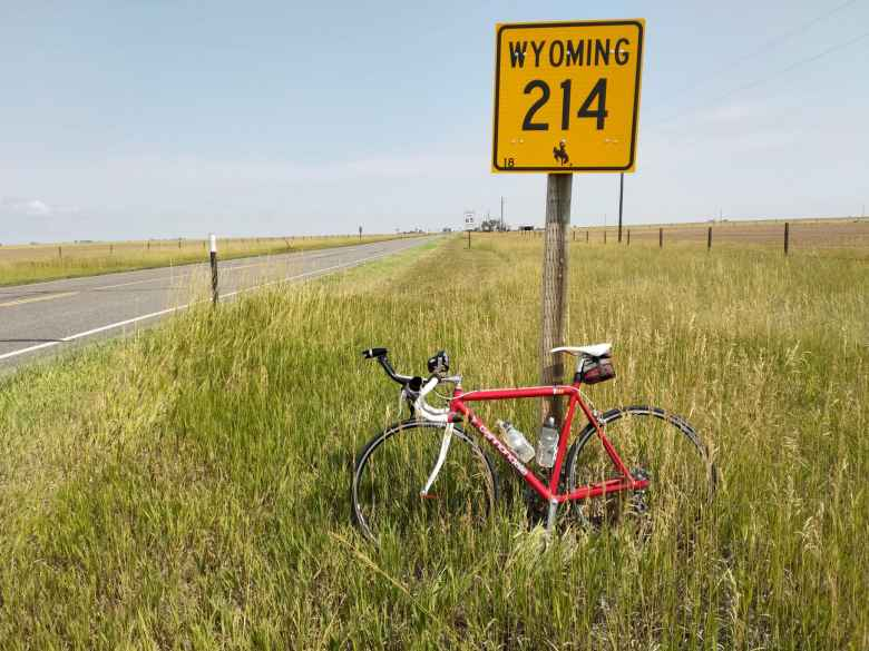Red 1992 Cannondale 3.0 with a Wyoming 214 sign.