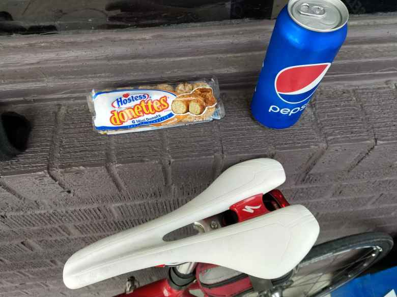 Hostess Donettes and a 16-ounce Pepsi from a convenience store. The white bicycle saddle is a Specialized Romin Evo Pro 143mm.