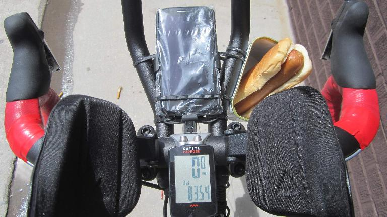 handlebars, red handlebar tape, aerobars, phone, cycle computer, hot dog