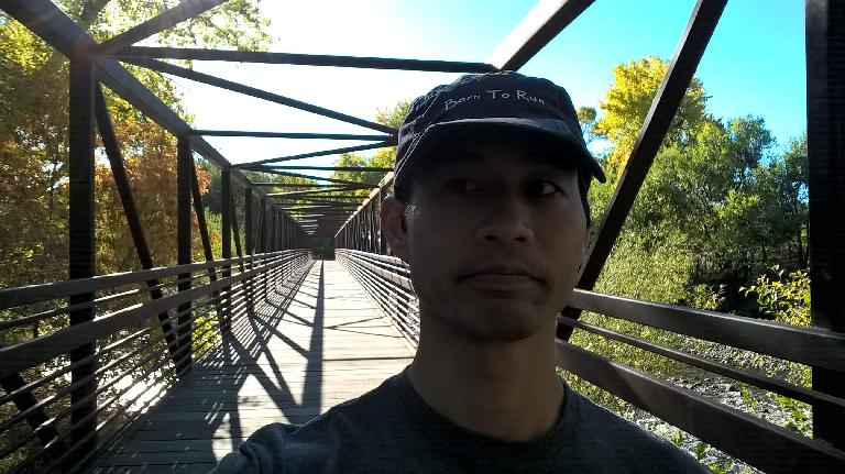 Felix Wong on the bridge at Butterfly Woods Natural Area, which is part of the Poudre River Trail.