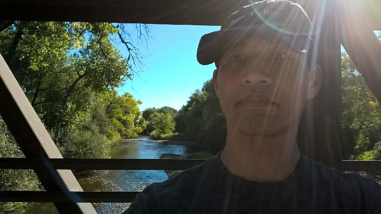 Felix Wong at Butterfly Woods with the Poudre River in the background.