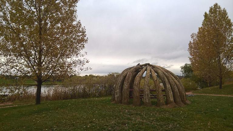 Semi-enclosed picnic table shelter at Fossil Creek Park.