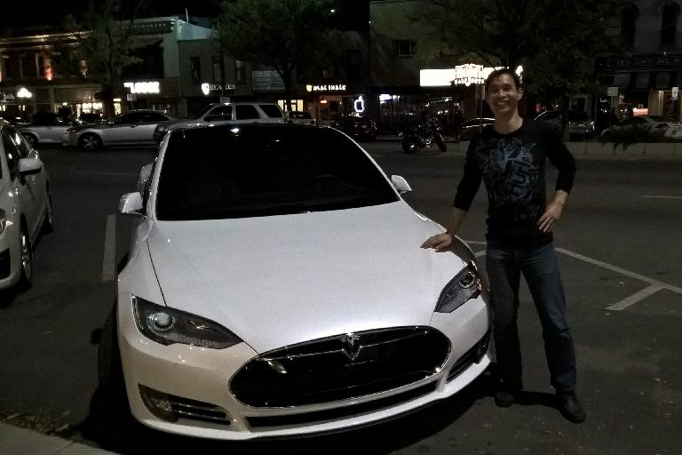 Felix Wong, white Tesla Model S