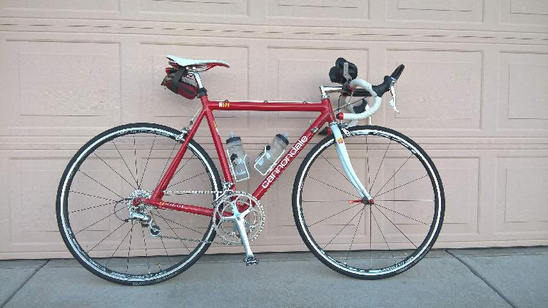 red 1992 Cannondale 3.0, R500, peach garage door