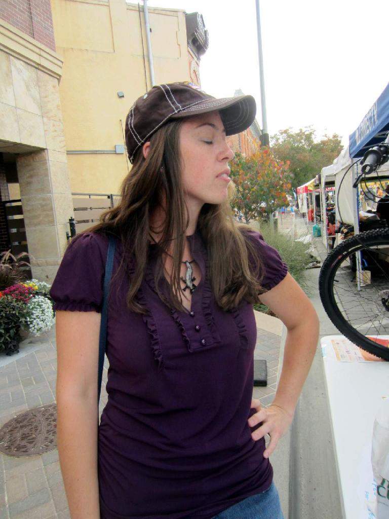 "Colleen modeling a hat I won for her by answering ""expert-level"" bicycle trivia questions correctly."