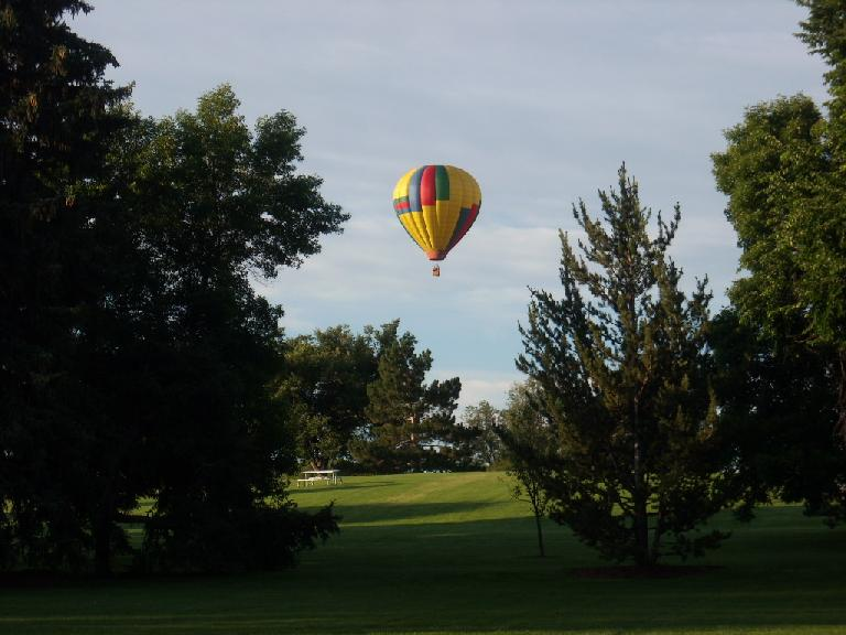 Hot air balloon launching from City Park in Fort Collins.