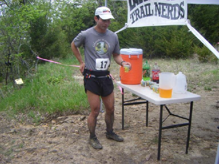 Filling up my four-ounce flasks with Succeed sports drink.  I drank about 13 pounds of fluids during the race.