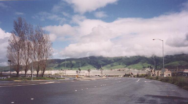 [Winter  2002] Aren't the Fremont foothills so nice and green this winter?  In front is the NUMMI plant (joint venture between Toyota and GM) across the highway from where I work. (March 1, 2002)