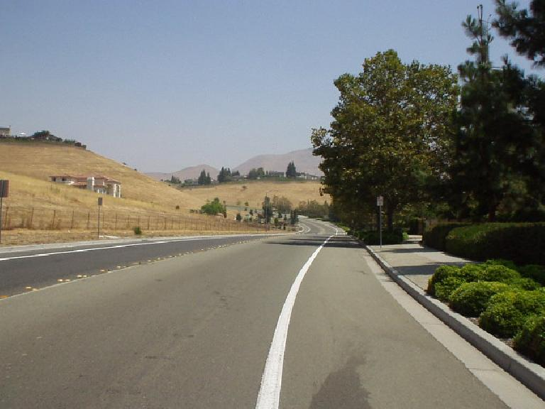 [Aug. 2002] Going on a lunchtime training ride on picturesque Paseo Padre Rd. and the foothills in the background. (August 13, 2002)