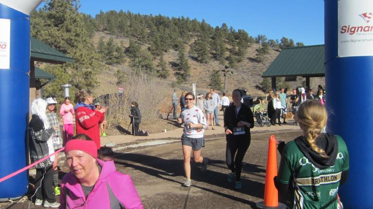 Dani and Katherine crossing the finish line.