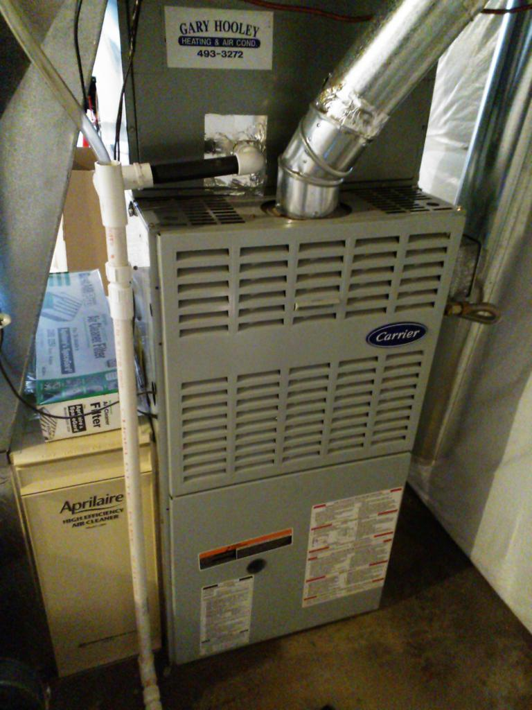 The furnace back together. I also cleaned up the condensate drain pipe a bit.