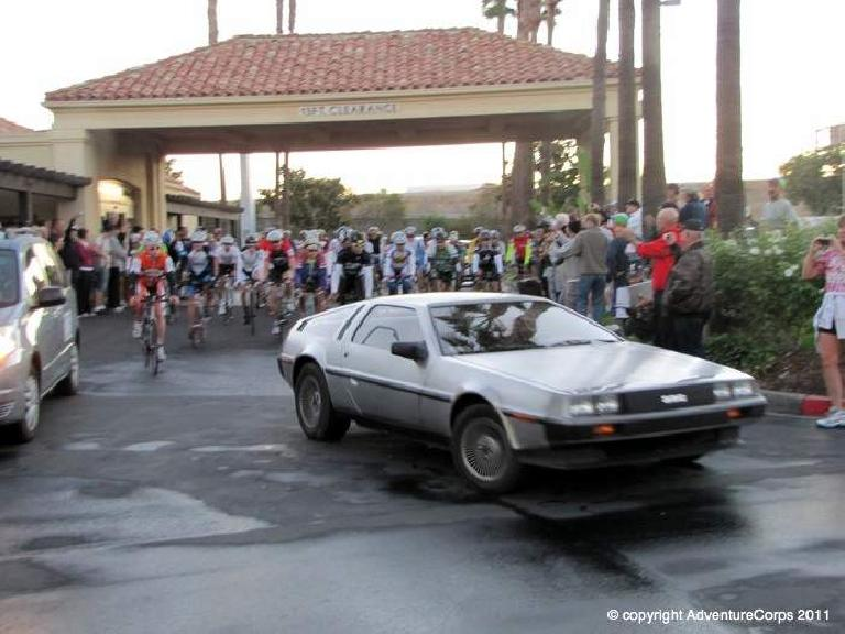 "[Mile 0, 7:00 a.m.] The race begins!  Adventure Corps race director Chris Kostman leads us out in a DeLorean as this year's race theme was ""Back to the Future."""