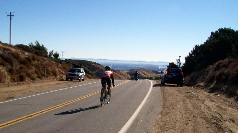 (Mile 24) Topping out Mountain Stage #1, which was a 20+ mile, 2500' climb. Photo: Raquel Engel.
