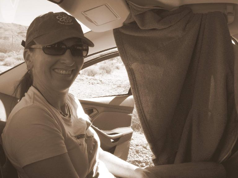 [Mile ~109, 2:25 P.M] Tori and her makeshift curtain. Photo: Raquel Engel.