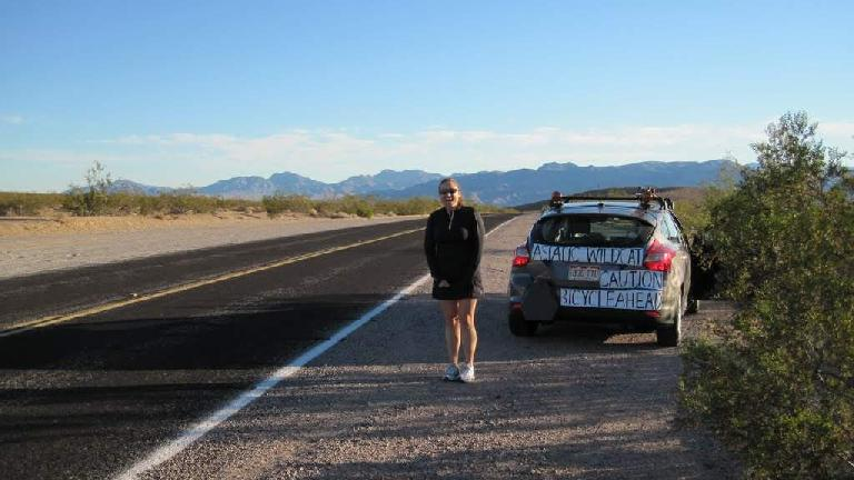 [Mile 324, 7:54 A.M.] Raquel and the Asiatic Wildcat crew vehicle await as I exit Death Valley National Park. Photo: Tori.