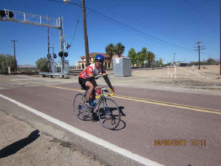 (Mile 417) Coming into Kelso after a 21-mile, 2500' climb (Mountain Stage #8) and a 1-hour, 10-mile descent on one of the most beat-up roads I have ever ridden. Photo: AdventureCorps.
