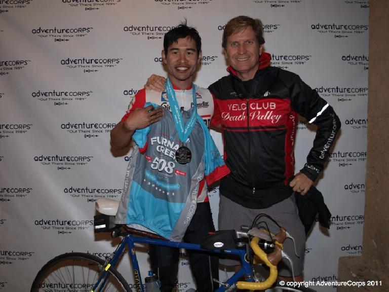 Felix Wong with Chris Kostman, founder of AventureCorps. Finishers got a blue finishing jersey. Photo: AdventureCorps.