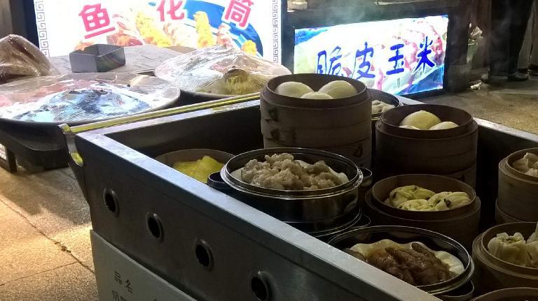 An outdoor cart of dim sum items in Fuzhou, China.