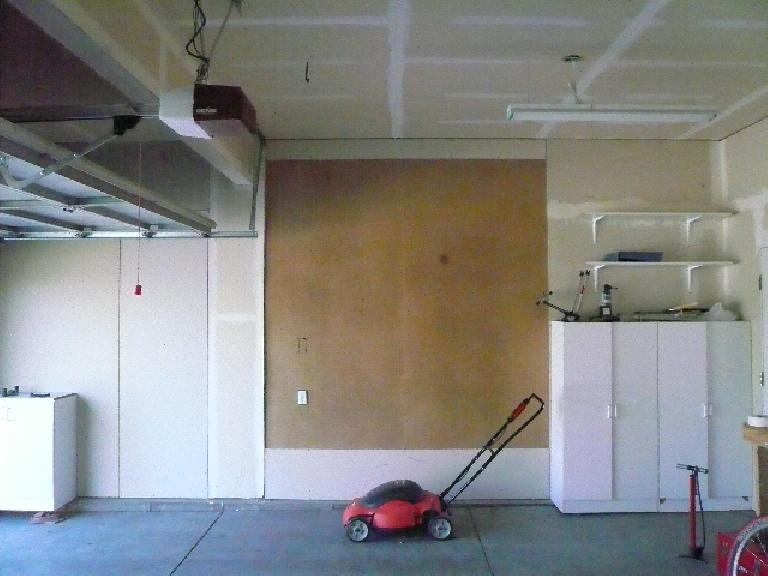 [Before] The garage had these pieces of ugly pegboard in place of drywall.  Note untaped drywall seams.