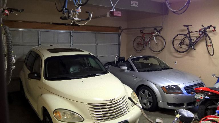 The Garage Mahal 2 in July 2016. The vehicles have changed a lot over the years. The bike hanging off the ceiling is my friend Erika's while she does Peace Corps in Ecuador. (August 14, 2016)