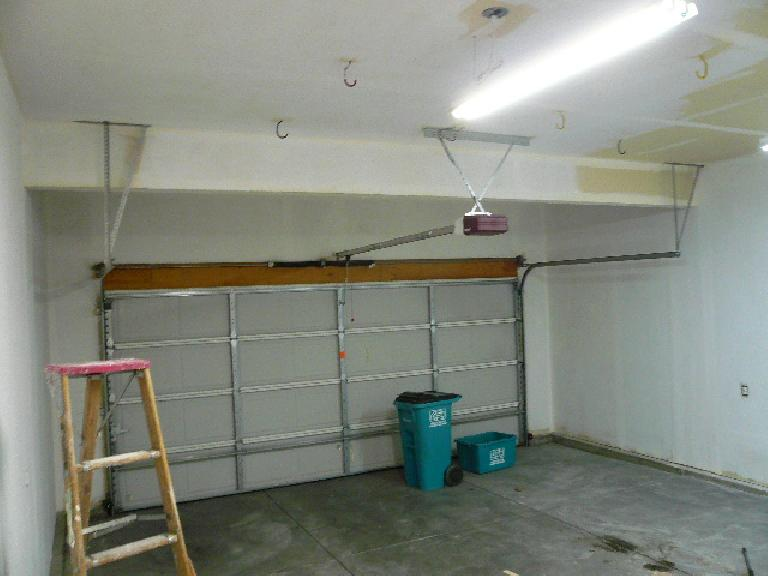 [Intermediate stage] Almost done applying white primer to every wall and ceiling surface.