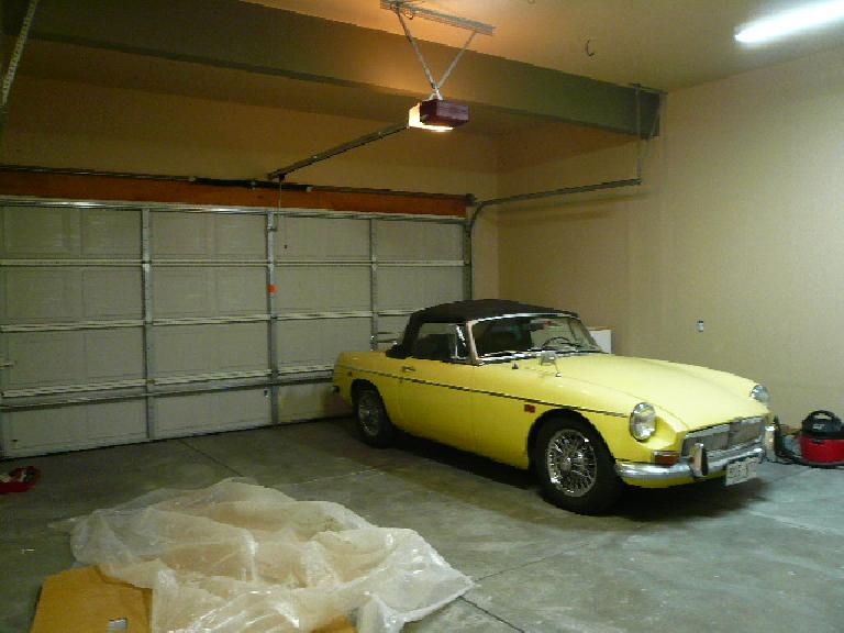 [After]  The walls have been painted!  I was even able to bring Goldie back in at this point (she was relegated to the street while the garage was primed).