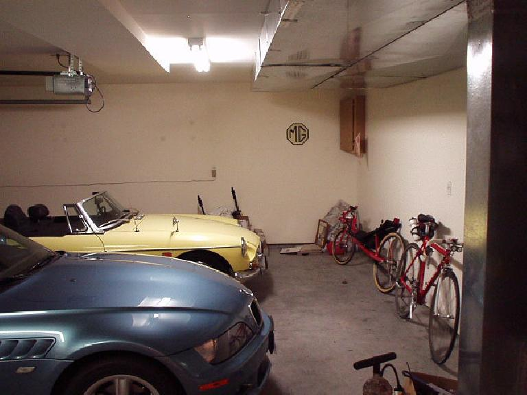 When I had moved in 2001, the garage was in unremarkable shape: lots of clutter, an ugly particle-board cabinet, and errant wire and spackle on the ho-hum white walls.  This would change! (July 1, 2001)