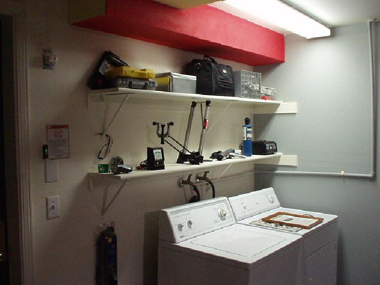 More useful tools on display, including my 1960s Sears dwell tachometer, timing gun, SU carburetor synchronizer, Minoura truing stand, battery charger, propane torch... (June 1, 2004)
