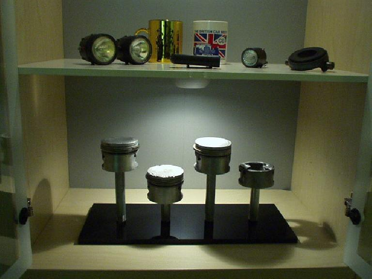 The Garage Mahal theme extends into rest of the house with Goldie's pistons (after they blew up) on display.  I may post some pics of my newly-painted living room, one day... (June 1, 2004)