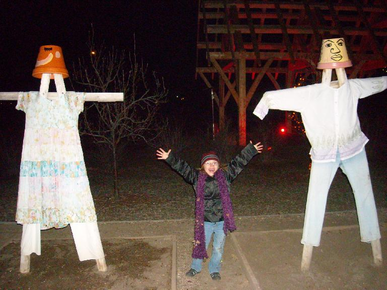 Faith and two scarecrows.