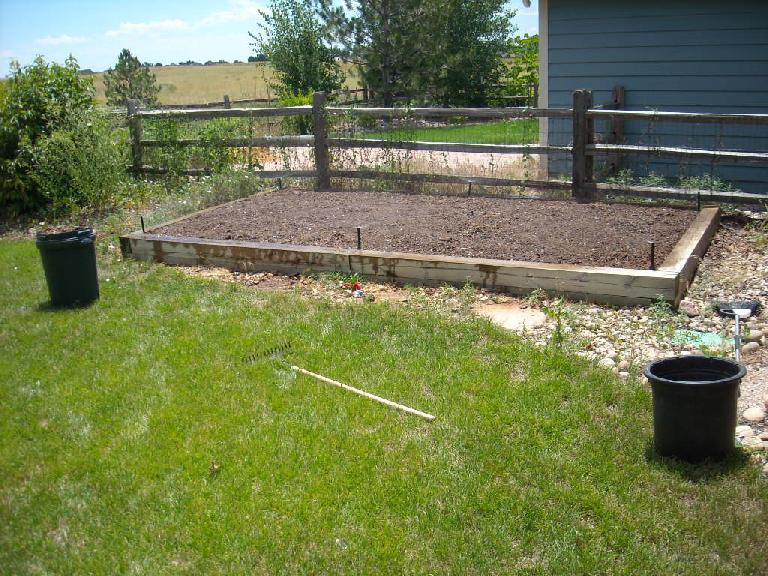 It took several hours, but eventually I had pulled out most of the weeds and bark mulch from the garden plot. (July 14, 2010)