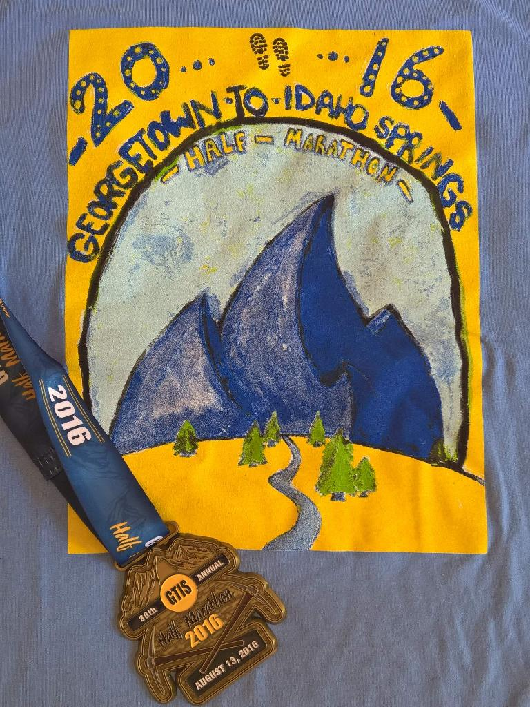 The 2016 Georgtown-Idaho Springs Half Marathon t-shirt and medal.