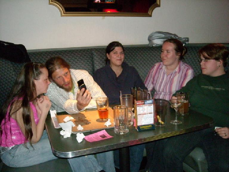 Ryan, Nick, Dana, Sei and Corinna hanging out in a booth to watch.