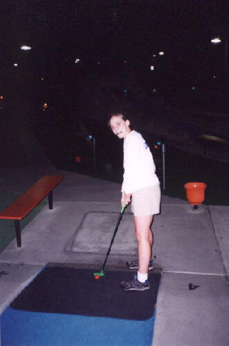... and even look cute with glasses and a pencil in her mouth.  Here Cathy gets ready to putt.