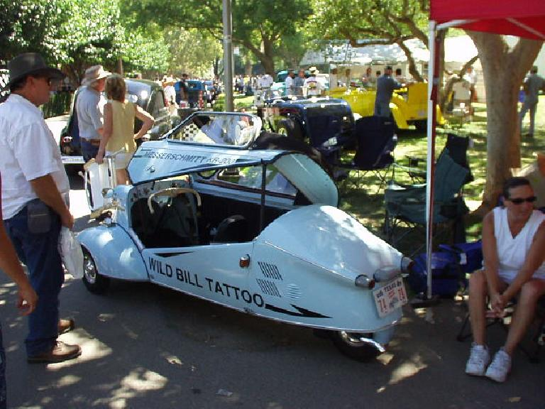 This is a Messerschmitt 3-wheeled vehicle, owned by Wild Bill Tattoo.  It has 10 hp and is good for 95 mpg!