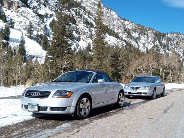 Silver Audi TT Roadster Quattro and Acura CL a mile west of Poudre Falls in the Poudre Canyon (CO-14).