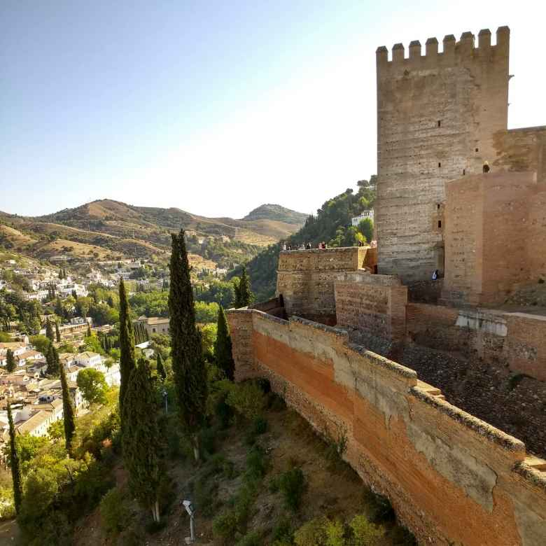 Stone tower walls of Alcazaba, south of the Albaicín district in Granada, Spain.