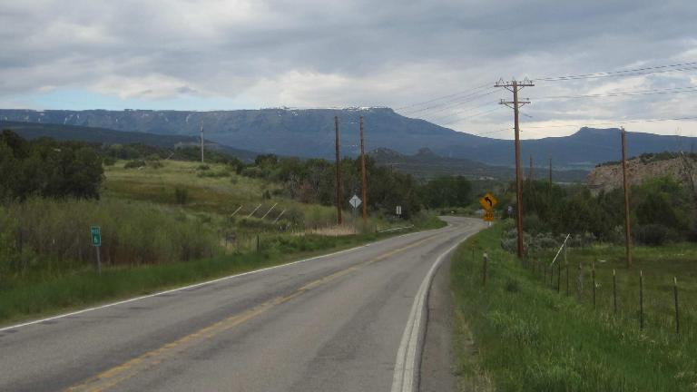 [Mile 51, 8:08 AM] Riding towards the Grand Mesa.